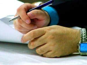 business signing Van Sant Law