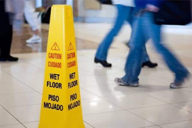slip and fall wet floor warning sign Van Sant Law
