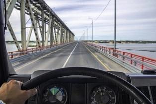 truck driver on open bridge no distractions
